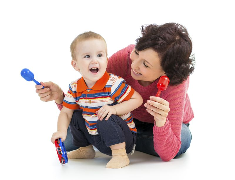 Mother-and-baby-boy-having-fun-with-musical-toys-000024704932_Large